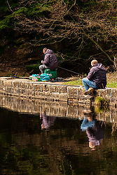 Sheffield South Yorkshire Saturday 4th April: <br /> Fishermen at Riverlin Dams along the Riverlin Valley Nature Trail, just of the A57 Manchester Road Sheffield flout the governments do not go out during the coronavirus Crisis unless its for: <br /> Shopping for basic necessities as infrequently as possible,<br /> One form of exercise a day,<br /> Any medical need, <br /> Traveling for work purposes<br /> <br /> 4 April 2020<br /> <br /> <br /> www.pauldaviddrabble.co.uk<br /> All Images Copyright Paul David Drabble - <br /> All rights Reserved - <br /> Moral Rights Asserted -