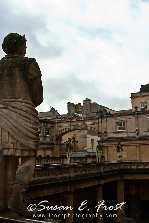 Roman statue overlooking the baths at Bath, England.