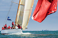 Cetewayo's crew haul in their spinnaker at the head of the fleet while competing on the Solent off the Isle of Wight during the Panerai British Classic Week, the premier classic yacht regatta in the UK which is now in it's 16th year. <br /> Picture date Monday 10th July, 2017.<br /> Picture by Christopher Ison. Contact +447544 044177 chris@christopherison.com