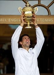 03.07.2011, Wimbledon, London, GBR, ATP World Tour, Wimbledon Tennis Championships, Finale, im Bild .Novak Djokovic (SRB) parades the trophy outside the Centre Court clubhouse after winning the Gentlemen's Singles Final match on day thirteen of the Wimbledon Lawn Tennis Championships at the All England Lawn Tennis and Croquet Club. EXPA Pictures © 2011, PhotoCredit: EXPA/ Propaganda/ David Rawcliffe +++++ ATTENTION - OUT OF ENGLAND/UK +++++
