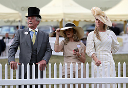 Racegoers watch the racing during day one of Royal Ascot at Ascot Racecourse.