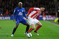 Arouna Kone of Everton (l)  challenges  Stoke city's Geoff Cameron. Barclays Premier League match, Stoke city v Everton at the Britannia Stadium in Stoke on Trent , Staffs on Wed 4th March 2015.<br /> pic by Andrew Orchard, Andrew Orchard sports photography.