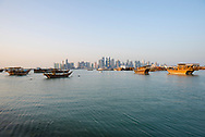 Dhows in Doha Bay and Doha skyline in Qatar