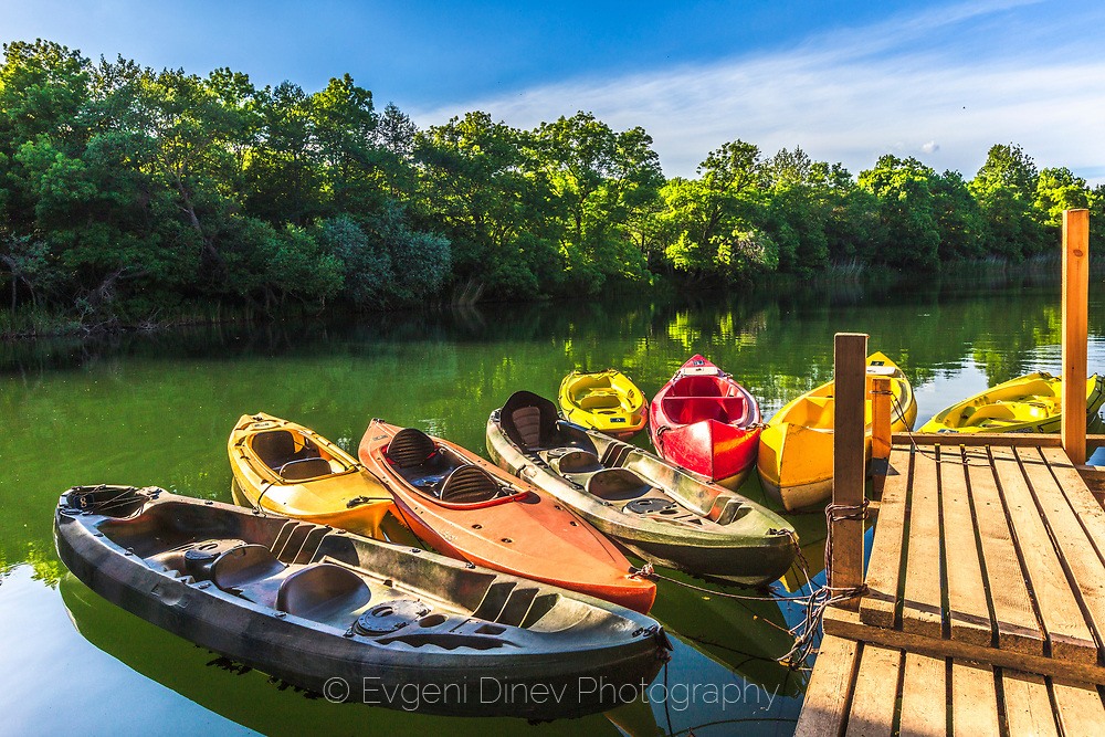 Colorful kayaks in a river