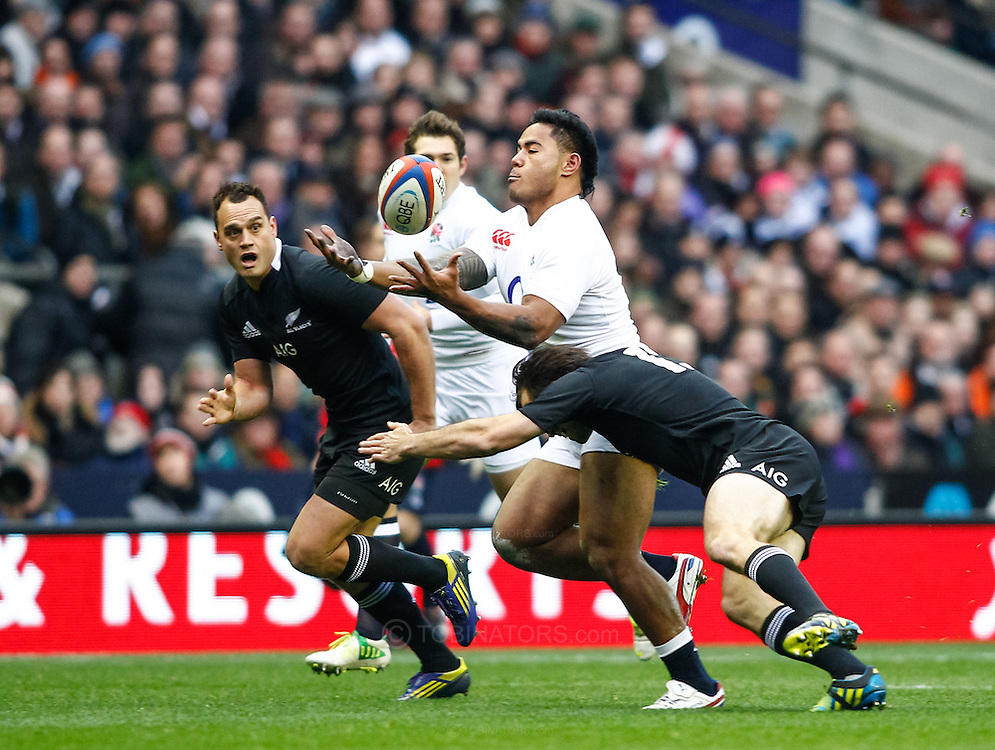 Picture by Andrew Tobin/SLIK images +44 7710 761829. 2nd December 2012. Manu Tuilagi of England catches a pass during the QBE Internationals match between England and the New Zealand All Blacks at Twickenham Stadium, London, England. England won the game 38-21.