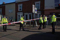 © Licensed to London News Pictures. 22/10/2021. London, UK. Police guard a crime scene in Woolwich, south London after a man in his 20s was found dead on the street. Police were called before 8am on Thursday 21st October to a report of a man collapsed in the street. He was pronounced dead at the scene. Photo credit: Marcin Nowak/LNP
