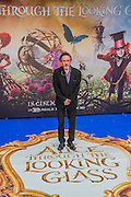 Tim Burton, director - Alice Through the Looking Glass premiere - a Walt Disney American fantasy adventure film directed by James Bobin, written by Linda Woolverton and produced by Tim Burton. It is based on Through the Looking-Glass by Lewis Carroll and is the sequel to the 2010 film Alice in Wonderland. The film stars Johnny Depp, Anne Hathaway, Mia Wasikowska, Rhys Ifans, Helena Bonham Carter, and Sacha Baron Cohen and features the voices of Alan Rickman, Stephen Fry, Michael Sheen, and Timothy Spall.