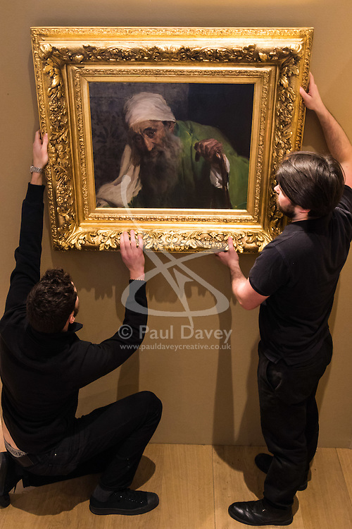 """Bonhams, Mayfair, London, February 26th 2016. Gallery technicians hang Joaquin Soralla y Basitda's """"Un Hebreo"""", estimated to fetch between £300,000-500,000 which will be on display until the Bonhams 19th Century Art Sale in Mayfair, London on march 2nd 2016. ///FOR LICENCING CONTACT: paul@pauldaveycreative.co.uk TEL:+44 (0) 7966 016 296 or +44 (0) 20 8969 6875."""