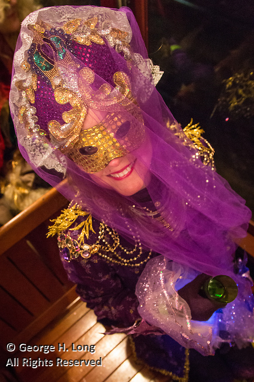 Courtney Blitch; The Phunny Phorty Phellows ride the streetcar heralding the Carnival season
