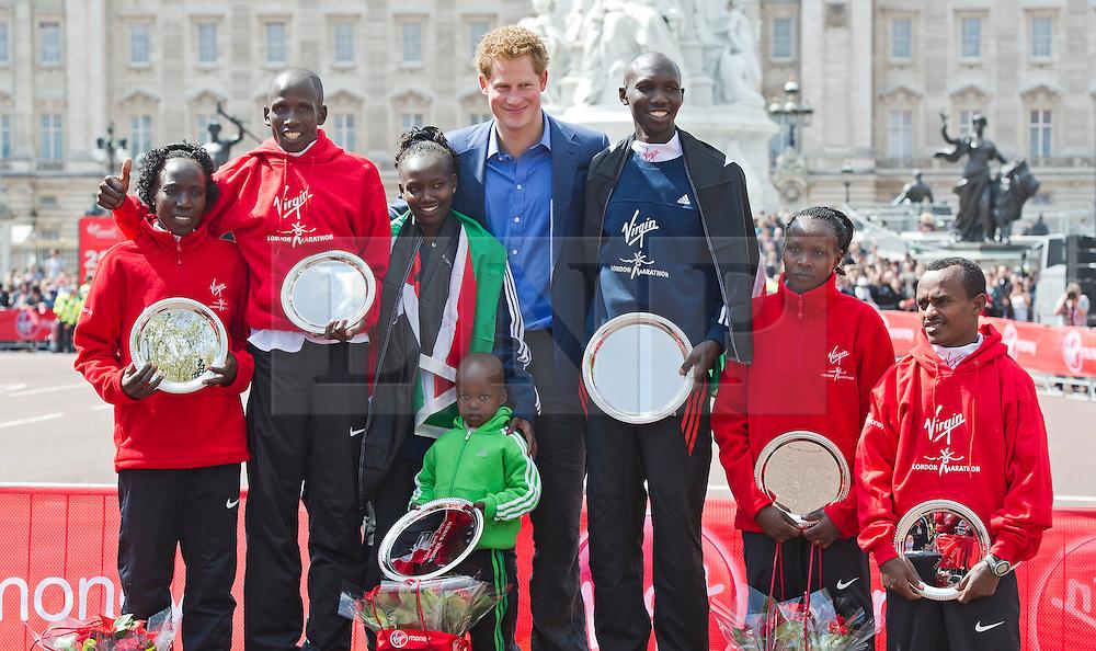 © London News Pictures. 22/04/2012. London, UK. Prince Harry poses with the London Marathon winners (L-R) Edna Kiplagat of Kenya, Martin Lel of Kenya, Mary Keitany of Kenya, Wilson Kipsang of Kenya, Priscah Jeptoo of Kenya and Adil Annani of Morocco after the 2012 Virgin London Marathon on April 22, 2012 in London, England . Photo credit : Ben Cawthra /LNP