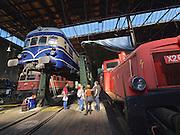 "Strasshof, Austria.<br /> Triebwagentage (railcar days) at Das Heizhaus - Eisenbahnmuseum Strasshof, Lower Austria's newly designated competence center for railway museum activities.<br /> Curator Rupert Gansterer (red polo shirt) with visitors at ÖBB 4145 ""Blauer Blitz (Blue Lightning)"", 1952-1962, running until 1997, undergoing an axle revision."