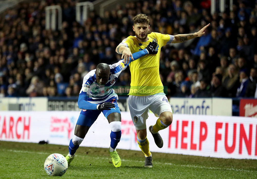 Leeds United's Mateusz Klich in action with Reading's Modou Barrow during the Sky Bet Championship match at the Madejski Stadium, Reading.