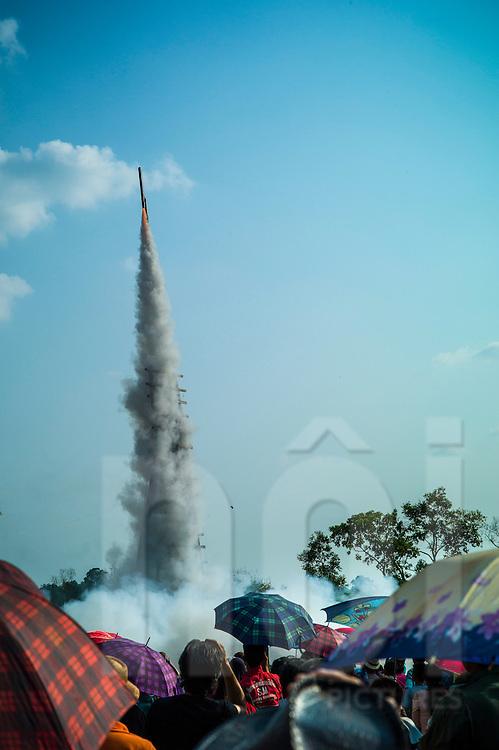 Launching of a rocket during Boun Bang Fai, aka Rocket Festival, Ban Don Nieng, a small village near Vientiane, Laos, Southeast Asia