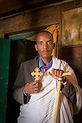 A Priest inside Wukro Cherkos, a cruciform rock hewn church near the town of Wukro. Ethiopia, Horn of Africa
