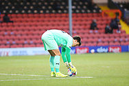 Wigan Athletic goalkeeper Owen Evans (25) places the the ball down for a goal kick during the EFL Sky Bet League 1 match between Rochdale and Wigan Athletic at the Crown Oil Arena, Rochdale, England on 16 January 2021.