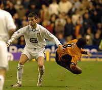 Picture: Henry Browne.<br /> Date: 20/12/2003.<br /> Wolverhampton Wanderers v Leeds United FA Barclaycard Premiership.<br /> Eirik Bakke knocks over Paul Ince.