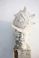 Buddha with a big seashell hat on his head. :). I can go anywhere I want in my mind and I AM. The Hardlight Studio.