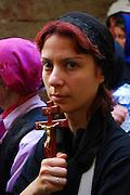Israel, Jerusalem The Via Dolorosa Procession, Good Friday, Easter 2007. Female pilgrim holding a crucifix