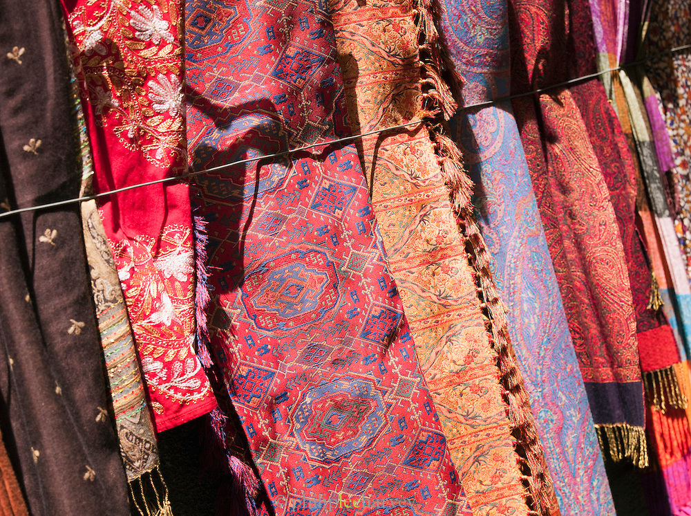 Fabrics for sale at a stall in a souq in the Old City in Damascus, Syria