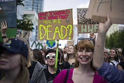 May 24, 2019 - Warsaw, Mazowieckie, Poland - A protester seen holding a placard that says have you heard the news that you're dead? during the demonstration..Young people who want to pay attention to the effects of climate change, protested on the streets of Warsaw. The Youth Strike for Climate is an initiative of pupils and students of Polish schools as they emphasize. The demonstration was inspired by 16-year-old activist Greta Thunberg, who started similar strikes in Sweden last year. (Credit Image: © Attila Husejnow/SOPA Images via ZUMA Wire)