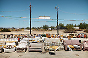 """Slab City or The Slabs is a camp in the Colorado Desert in southeastern California, used by recreational vehicle owners and squatters from across North America..Several thousand campers, many of them retired, use the site during the winter months. These """"snowbirds"""" stay only for the winter, before migrating north in the spring to cooler climates. The temperatures during the summer are unforgiving; nonetheless, there is a group of around 150 permanent residents who live in the Slabs all year round. Most of these """"Slabbers"""" derive their living by way of government checks (SSI and Social Security) and have been driven to the Slabs through poverty...A 4-weeks road trip across the USA, from New York to San Francisco, on the steps of Jack Kerouac's famous book """"On the Road"""".  Focusing on nomadic America: people that live on the move across the US, out of ideology or for work reasons."""
