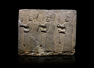 Hittite monumental relief sculpted orthostat stone panel of a Procession. Basalt, Karkamıs, (Kargamıs), Carchemish (Karkemish), 900-700 B.C.  Marching female figures. Anatolian Civilisations Museum, Ankara, Turkey.<br /> <br /> It is a depiction of three marching female figures in long dress with a high headdress at their head. These women are considered to be the nuns of the Goddess Kubaba. They have a bunch of Spica in their right hand, and objects similar to a sceptre in their left hand. <br /> <br /> Against a black background. .<br />  <br /> If you prefer to buy from our ALAMY STOCK LIBRARY page at https://www.alamy.com/portfolio/paul-williams-funkystock/hittite-art-antiquities.html  - Type  Karkamıs in LOWER SEARCH WITHIN GALLERY box. Refine search by adding background colour, place, museum etc.<br /> <br /> Visit our HITTITE PHOTO COLLECTIONS for more photos to download or buy as wall art prints https://funkystock.photoshelter.com/gallery-collection/The-Hittites-Art-Artefacts-Antiquities-Historic-Sites-Pictures-Images-of/C0000NUBSMhSc3Oo