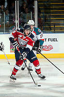 KELOWNA, CANADA - MARCH 8: Justin Kirkland #23 of the Kelowna Rockets checks Lucas Nickles #9 of the Tri City Americans as he skates with the puck during first period on March 8, 2014 at Prospera Place in Kelowna, British Columbia, Canada.   (Photo by Marissa Baecker/Getty Images)  *** Local Caption *** Justin Kirkland; Lucas Nickles;