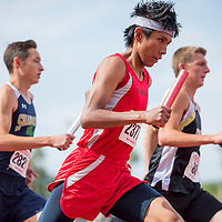 050914       Cable Hoover<br /> <br /> St. Michaels Cardinal Devin Fatt makes his way through the first turn in the 4x800-meter relay during the Arizona State Track Meet at Mesa Community College in Mesa Friday.