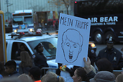 November 13, 2016 - New York City, New York, US - Anti-Donald Trump protests continued for a fifth day in New York City. Dubbed the 'ÄòHere to Stay'Äô Rally and March saw some of the largest crowds yet to protest the apprentice President-elect Donald Trump, to date. The early afternoon demonstration gathered for the rally at the Trump International Hotel and Tower on Central Park West, drawing large numbers of immigrants and supportive New Yonkers, then marched to the US President-elect home and headquarters on Fifth Avenue, where the demonstration continued. (Credit Image: © 2016 G. Ronald Lopez via ZUMA Wire)