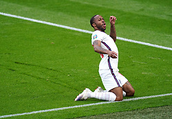 England's Raheem Sterling celebrates scoring their side's first goal of the game during the UEFA Euro 2020 Group D match at Wembley Stadium, London. Picture date: Tuesday June 22, 2021.