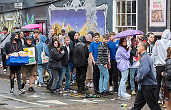 © Licensed to London News Pictures; 11/07/2021; Bristol, UK. England fans queue in the rain to watch the Euro 2020 Final between England and Italy being shown at the Full Moon pub and Attic Bar on Stokes Croft. Photo credit: Simon Chapman/LNP.