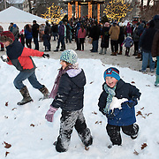 BRUNSWICK, Maine  11/24/18 -- Callen Sutton, 5, right and his sister, Haley Sutton, 8, center, of Brunswick, play with snowballs while waiting to see Santa at the tree lighting event on Saturday in Brunswick. Photo by Roger S. Duncan for the Forecaster