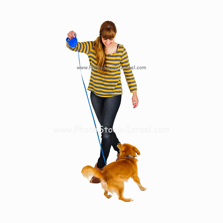 Young woman walks her dog Studio shot white background