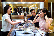 HONG KONG - MAY 04: Patricia Szeto and Jonathan Lui shop for jewels in a jewelry store  in Central business district, on May 4, in Hong Kong. (Photo by Lucas Schifres/Pictobank)