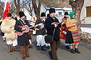 Folk Musicians on the Monady house visits of  the Busojaras Spring  festival 2010 Mohacs Hungary - Stock photos .<br /> <br /> Visit our HUNGARY HISTORIC PLACES PHOTO COLLECTIONS for more photos to download or buy as wall art prints https://funkystock.photoshelter.com/gallery-collection/Pictures-Images-of-Hungary-Photos-of-Hungarian-Historic-Landmark-Sites/C0000Te8AnPgxjRg