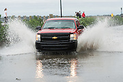 A truck drives through flood water along the Battery in historic downtown after Hurricane Matthew passed through causing flooding and light damage to the area October 8, 2016 in Charleston, South Carolina. The hurricane made landfall near Charleston as a Category 2 storm but quickly diminished as it moved north.
