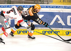 03.01.2021, Keine Sorgen Eisarena, Linz, AUT, ICE, Black Wings 1992 vs iClinic Bratislava Capitals, im Bild v.l. Lukas Bohunicky (iClinic Bratislava Capitals), Dragan Umicevic (Steinbach Black Wings 1992) // during the bet-at-home ICE Hockey League match between Black Wings 1992 and iClinic Bratislava Capitals at the Keine Sorgen Eisarena in Linz, Austria on 2021/01/03. EXPA Pictures © 2020, PhotoCredit: EXPA/ Reinhard Eisenbauer