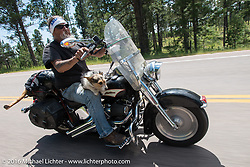"""Ed Rieken, the subject of the photo """"Early Morning"""" and his dog Jackson on the Annual Cycle Source and Michael Lichter Rides (combined this year) left from the new Broken Spoke area of the Iron Horse Saloon during the Sturgis Black Hills Motorcycle Rally. SD, USA.  Wednesday, August 10, 2016.  Photography ©2016 Michael Lichter."""