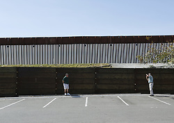 March 29, 2019 - San Diego, California, U.S - March 29, 2019 - San Diego, California, USA - Pedestrians take a photo along the United States - Mexico border in San Diego, near the San Ysidro Port of Entry, one of the busiest land border crossings in the world. (Credit Image: © KC Alfred/ZUMA Wire)