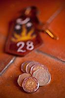 Peruvian money and hotel key.