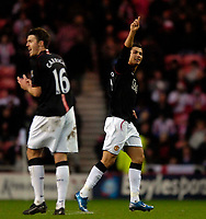 Photo: Jed Wee/Sportsbeat Images.<br /> Sunderland v Manchester United. The FA Barclays Premiership. 26/12/2007.<br /> <br /> Manchester United's Cristiano Ronaldo (R) acknowledges the fans after his goal as team mate Michael Carrick applauds the freekick.