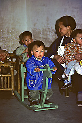 Children Playing At Factory For Disabled