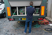 Television technician working amongst equipment and complicated wires prior to the broadcast of the BAFTA Awards in London, England, United Kingdom.