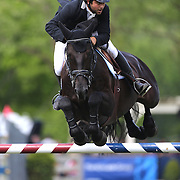 Axel Barrios riding VDL Aberlino in action during the $100,000 Empire State Grand Prix presented by the Kincade Group during the Old Salem Farm Spring Horse Show, North Salem, New York,  USA. 17th May 2015. Photo Tim Clayton