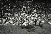 January 13, 1996, Orlando, Florida, USA;  Chad Pederson(28), and Jeff Dement(49) come over a jump in the 125cc Final at the 1993 Monster Energy AMA Supercross Championship at the Citrus Bowl.