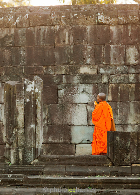 A Buddhist monk among the temples of Angkor, Siem Reap Province, Cambodia