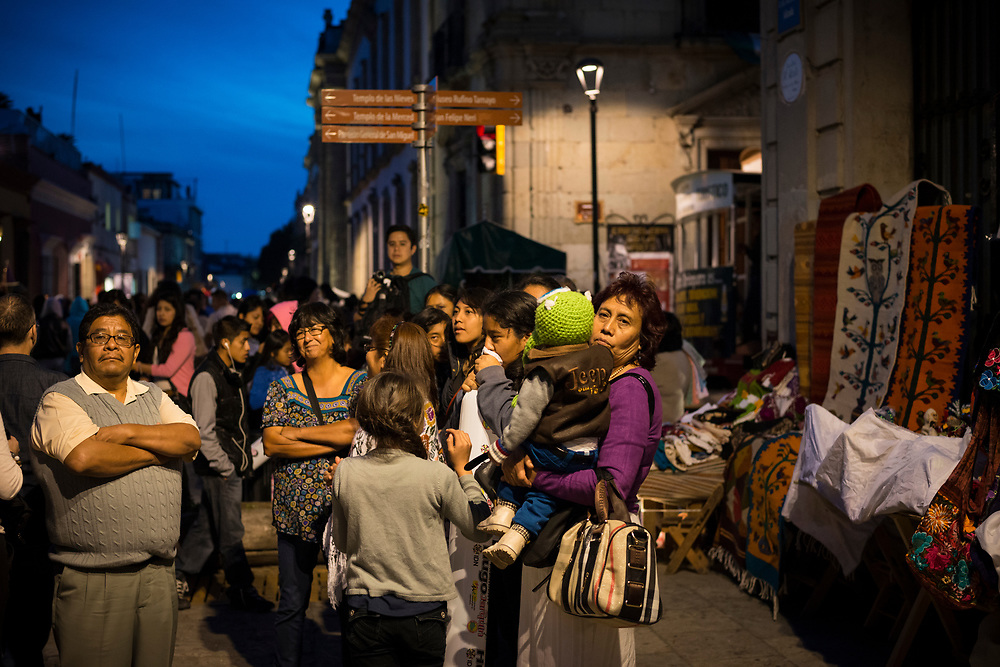 People enjoy a beautiful evening outdoors during Day of the Dead celebrations in Oaxaca, Mexico.