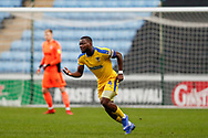 Wimbledon defender Adedeji Oshilaja (4) in action  during the EFL Sky Bet League 1 match between Coventry City and AFC Wimbledon at the Ricoh Arena, Coventry, England on 12 January 2019.