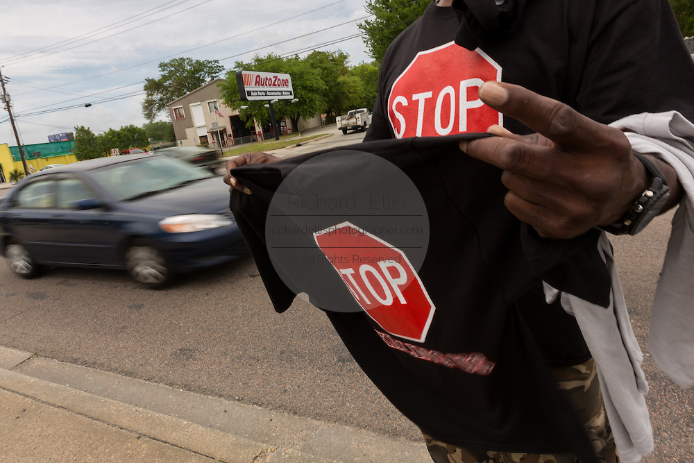 A vendor sells Black Lives Matter tee-shirts to passing motorists near the spot where unarmed black motorist Walter Scott was gunned down by police following a traffic stop April 10, 2015 in Charleston, South Carolina. Scott was shot multiple times in the back and died on the scene after running from police.