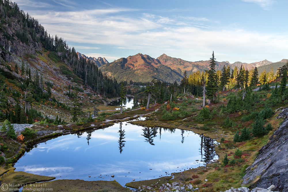 Austin Pass Lake in the Heather Meadows and Bagley Lakes area of the Mount Baker-Snoqualmie National Forest of Washington State, USA.  Mount Larabee and other peaks of the North Cascades Range are in the background.